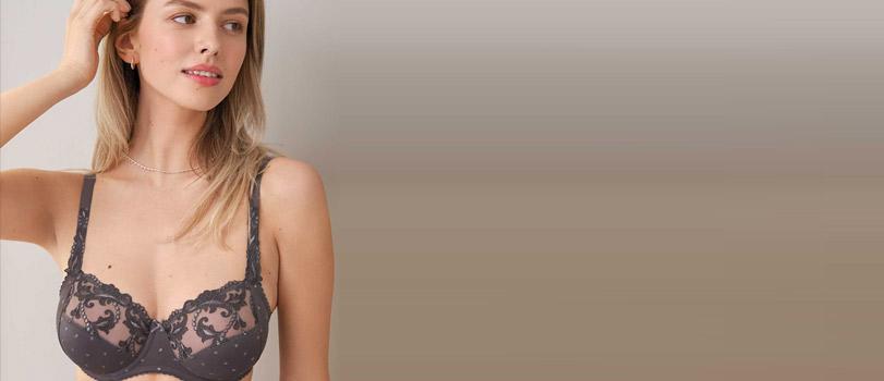 Model wearing a G cup bra designed by Felina
