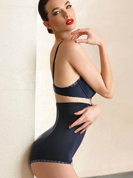 Model wearing a black high waist satin panty