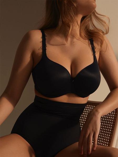 Model wearing a black shaping G string